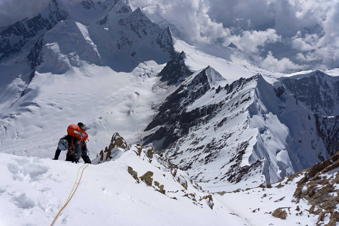 Jeff Shapiro on the right flank of the upper southwest ridge of Brammah II during the second day of the 2016 ascent. The original 1975 Japanese route followed this ridge from its base.