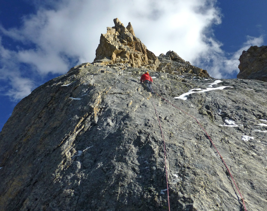 Ian Dring leading the crux slab below the Flaming Tower on the first ascent of Marikula Killa.