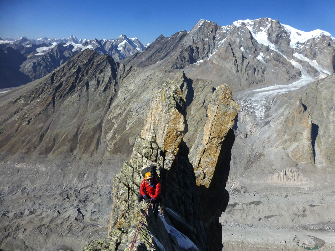 Ian Dring enjoying great ridge climbing above the Flaming Tower during the first ascent of Marikula Killa. At the head of a side glacier north of the Jangpar stands an unnamed peak of around 6,000m.