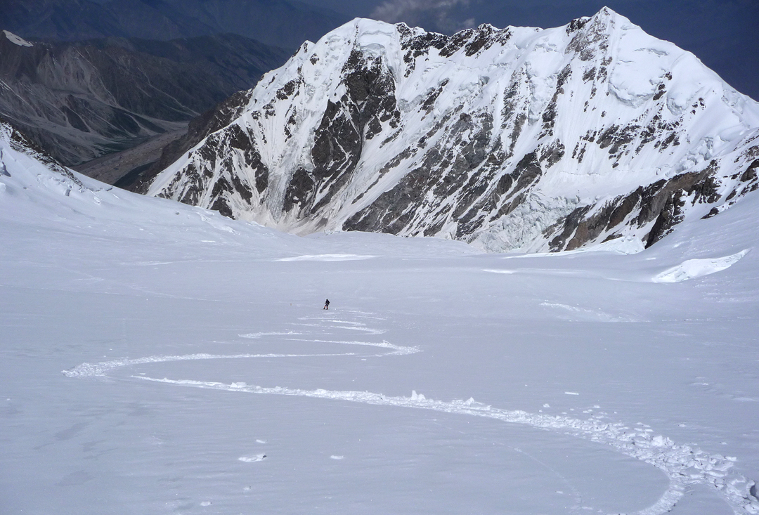 Skiing down the northwest face of Nanga Parbat with Ganalo Peak below.