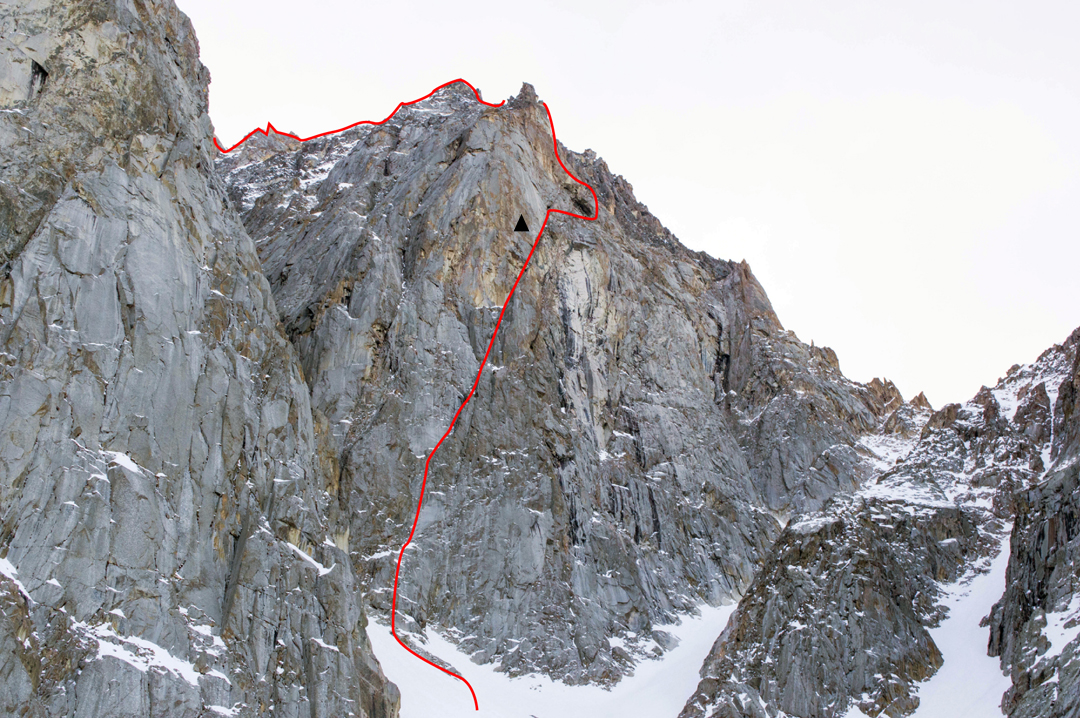 The new route on the right-hand rock buttress of the northwest face of Chon-tor. The altitude of the base of this buttress, which lies above a broad 30° snow couloir, is approximately 3,250m.