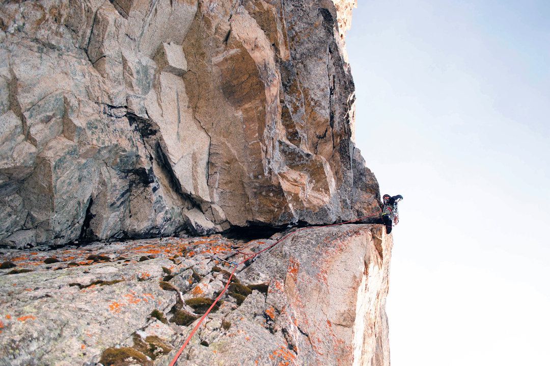 Eugeny Glaznov on one of the most difficult parts of the new route on the northwest face of Chon-tor, an overhanging section on the sixth pitch.