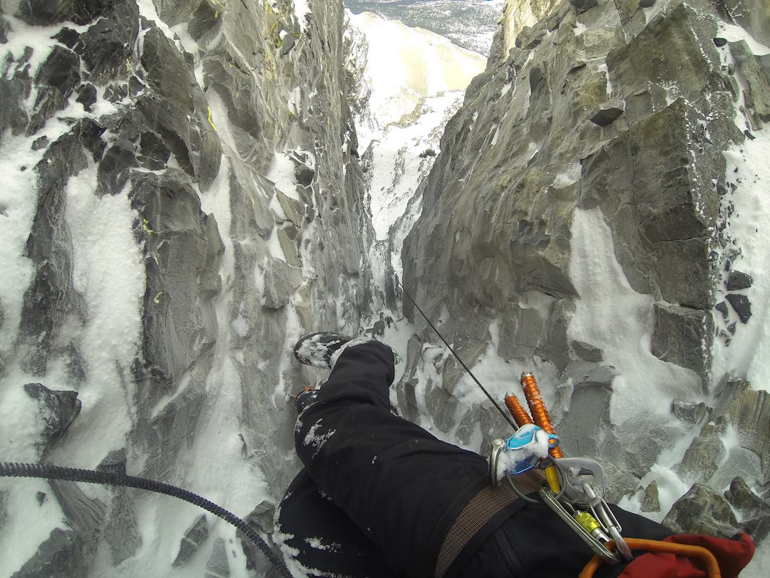 Looking down one of the crux passages of Infinite Patience on the Emperor Face of Mt. Robson.