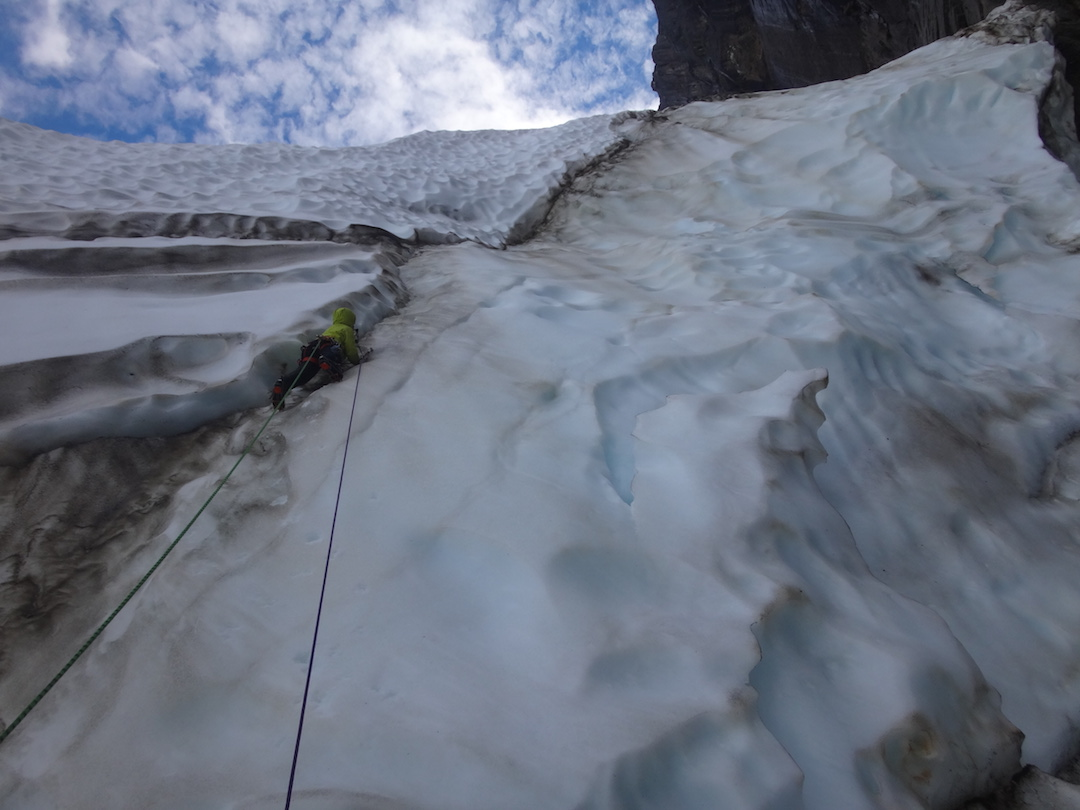 Silvan Schüpbach leading the overhanging ice of the glacier with only four screws available for 40 meters of climbing.