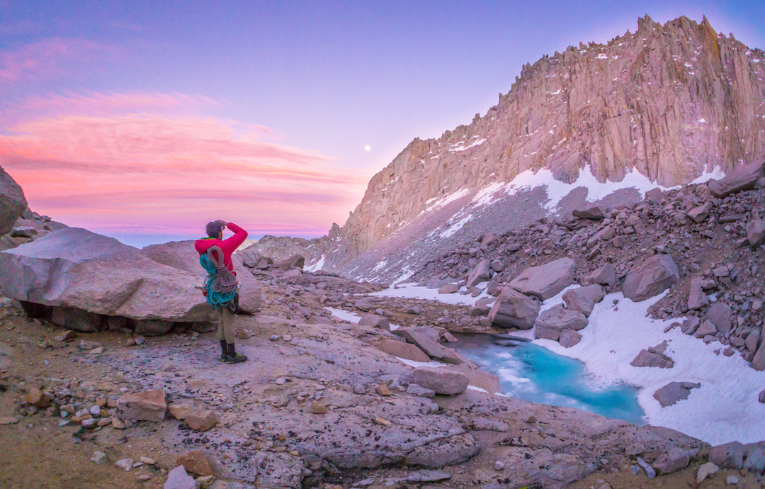 Austin Siadak savors the alpenglow after a new route on Mt. Whitney.