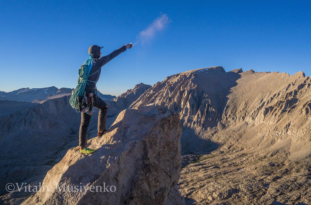 The author scatters ashes of Edward Lau from the summit of Mt. Hitchcock after another new route. Lau's death at a young age inpsired Musiyenko to make the most of his summer in the Sierra.