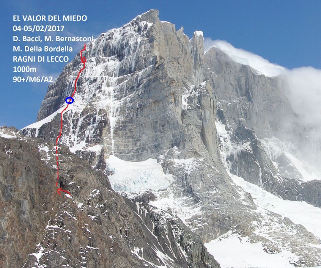 The east face of Cerro Murallón, showing the line of El Valor del Miedo (2017) and the team's bivy site on the route. Blue circle marks the Ragni (Italian) climbers' high point in 1984. The northeast arête, climbed by the Ragni team in 1984, is in the center.