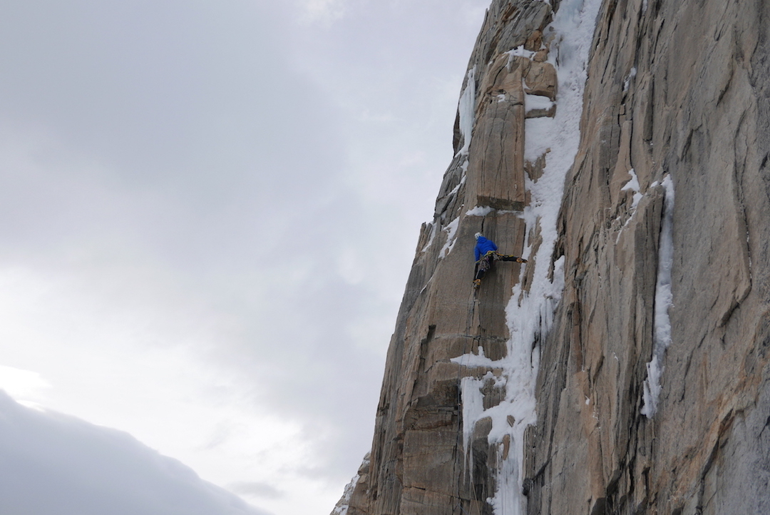 David Bacci leads a delicate mixed pitch just above the bivouac during the first ascent of the east face of Cerro Murallón.