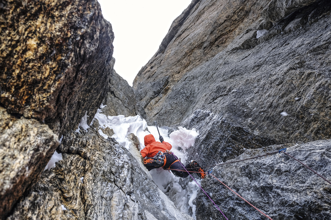 "Starting the second pitch on the second day of All or Nothing. Marko Prezelj spent much time cleaning snow to find placements for tools and protection. ""The mixed climbing game was as enjoyable as it can get on such terrain."""