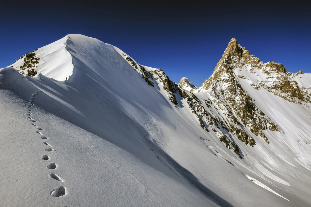 Approaching the ca 5,700m dome-like summit south of Peak 6,038m. From this top, the Slovenian team descended to the saddle on the right and downclimbed to their tent. Next morning they climbed back to the saddle, traversed to the left skyline ridge, and climbed the sharp summit.