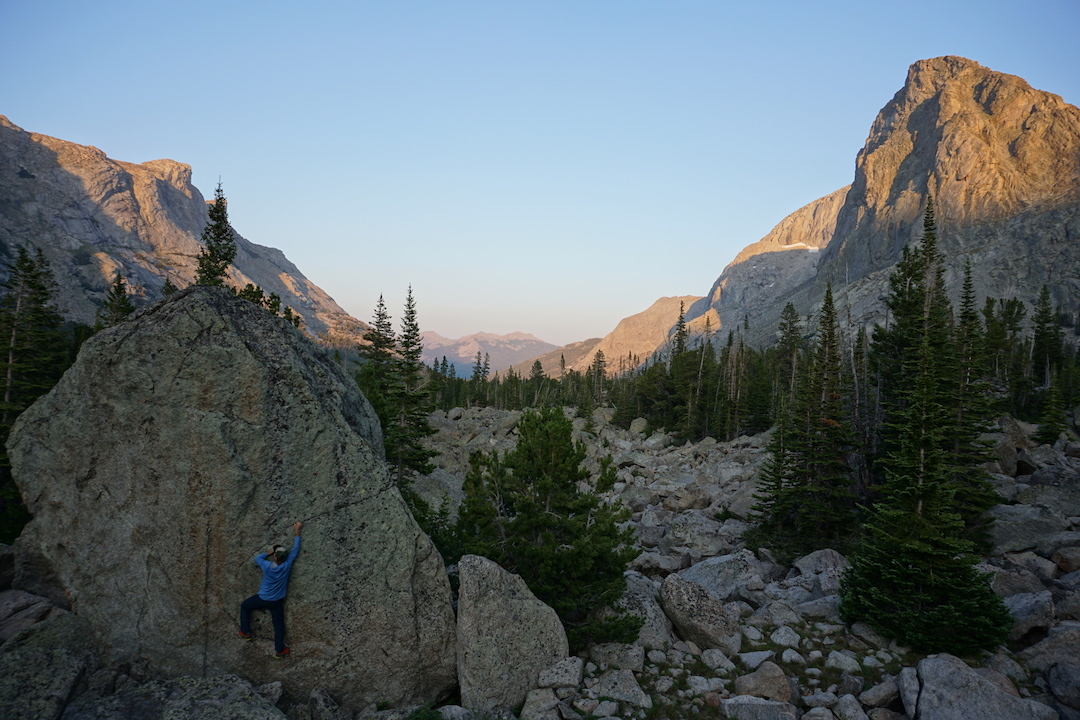 Drew Smith sneaks in a sunset bouldering session in the talus beside Papoose Lake.