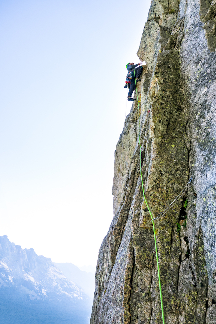 """Andy Anderson engaging steep, featured rock on the high-quality """"hourglass pitch"""" during the first ascent of Once Bitten (III/IV 5.10) on the Dogtooth Pinnacle."""