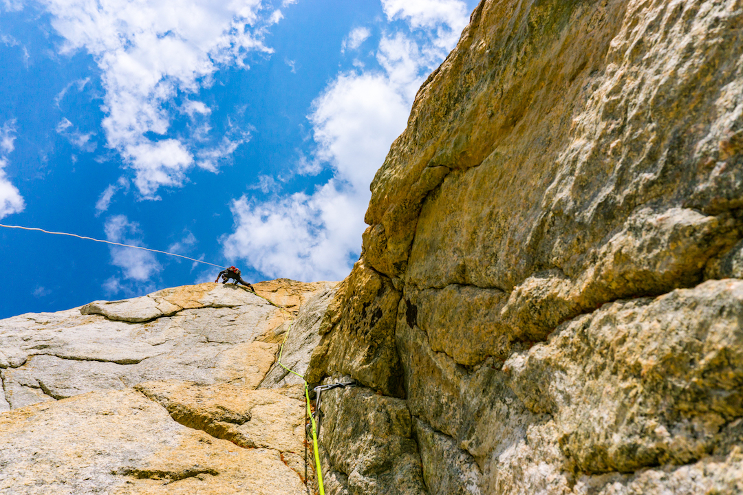 Andy Anderson aiding out an aesthetic arcing splitter during he and Drew Smith's attempt on the Dogtooth Pinnacle's southeast face. The two were shut down a few pitches above by crumbly rock and dead-end cracks.