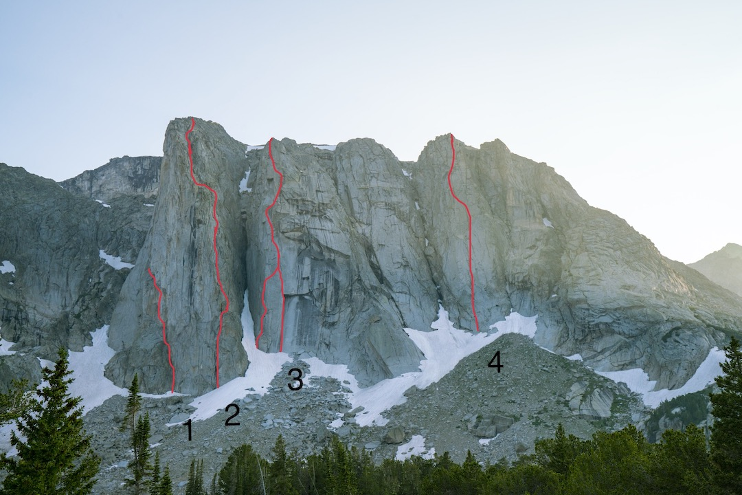 The east face of the Dog Tooth Peak massif, showing all known routes. (1) Dogtooth attempt (Anderson-Smith, 2017). (2) Once Bitten (III/IV 5.10, Anderson-Smith, 2017). (3) Infinite Jest (IV 5.11 C2, Barker-Daverin-Warren, 2016). (4) A-Frame Buttress (IV 5.9, Metcalf-Thuermer, 1977). The second buttress from the left experienced a major rockfall sometime in the '80s or '90s that obliterated the start of the buttress' original route, Wisdom Tooth (see AAJ 1981). Infinite Jest climbs new terrain down low and up high along a similar line (see AAJ 2017).The second buttress from the right is possibly unclimbed.