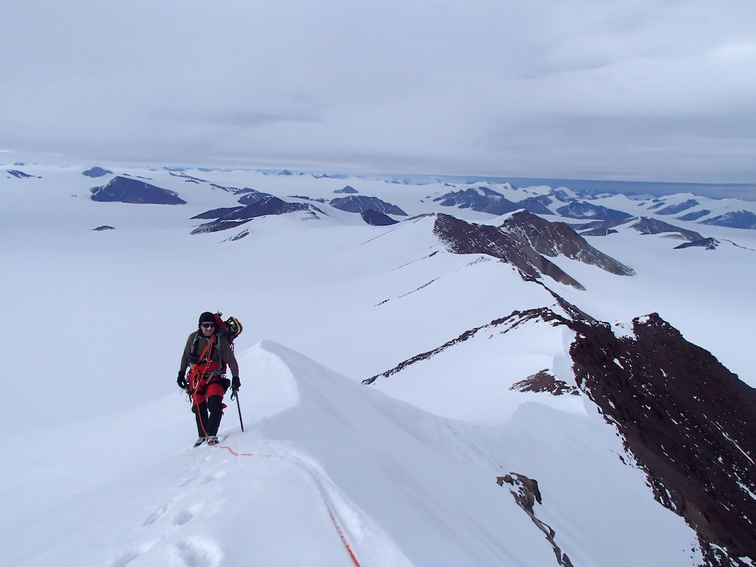 Brian Friedrich traversing the ridge southwest of Peak 2,016m. View looks northeast, with the Henrietta Nesmith Glacier below and Lake Hazen in the distance.