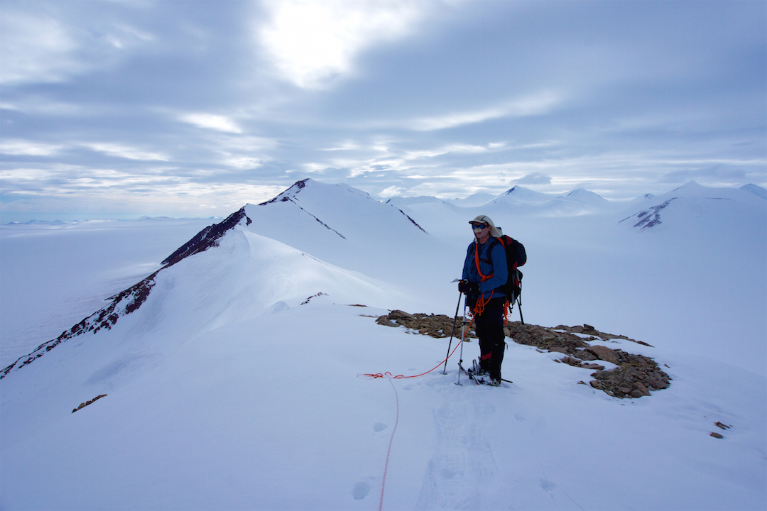 Eric Gilbertson heading southwest along the ridge back to camp. Peak 2,254m is the highest peak along the ridge to the left of Gilbertson; Barbeau Peak is just above and to the right of him; and Peak 2,359m is the second from the right edge of the frame.