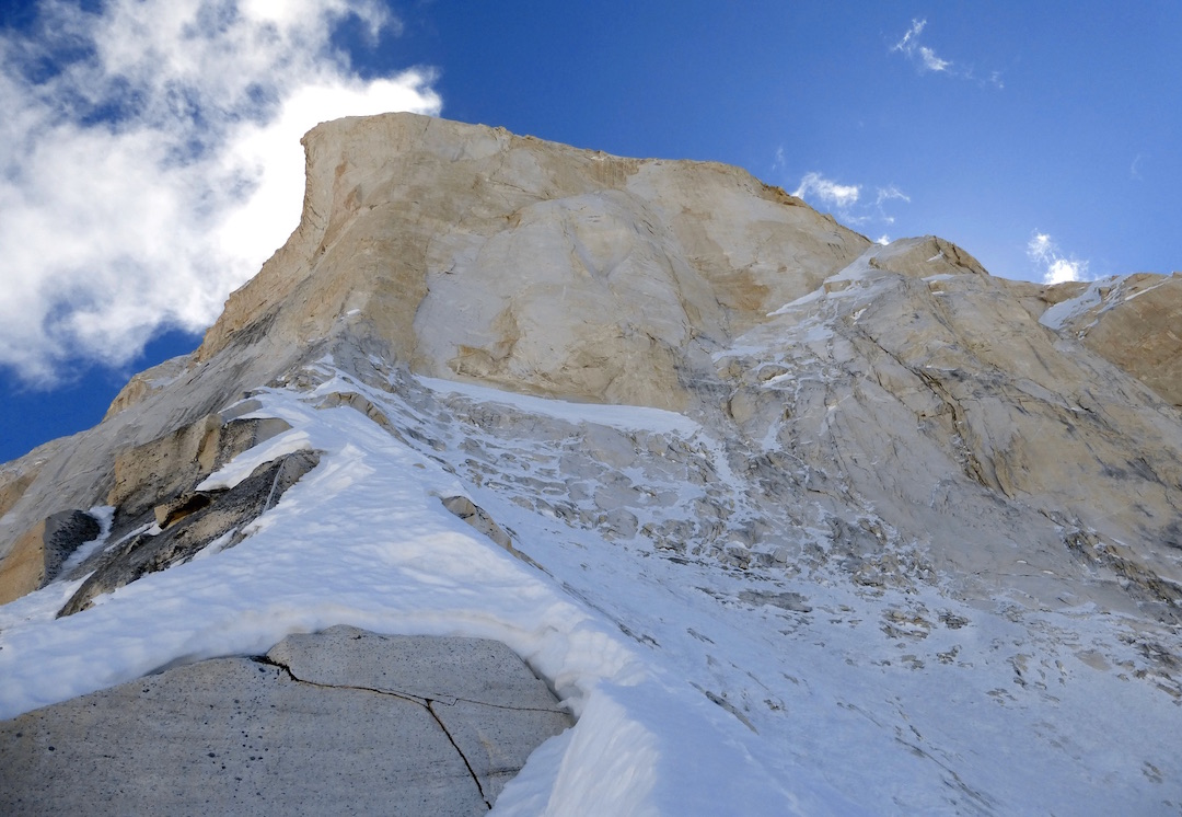 Looking up at the headwall on the north face of Shivling from the upper north ridge. The prow taken by Shiva's Line (2000) is directly above. The 1980 Japanese Route traversed the sloping snow terrace directly below the rock scar, then climbed the rightward ascending ramp. Shiva's Ice (2017) shortcut across the snow and ice slopes to the right in this picture to reach the ramp directly.