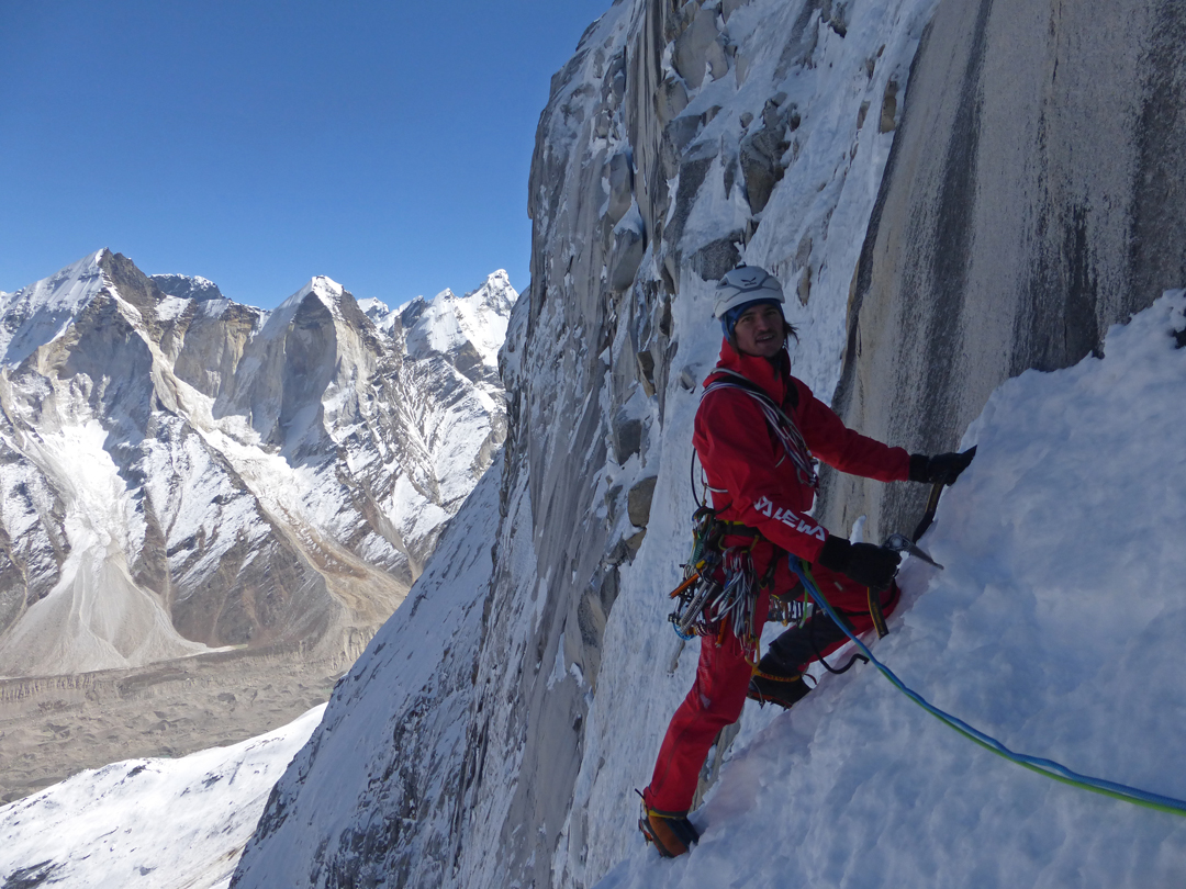 Simon Gietl traversing toward the start of the lower water ice on the northeast face of Shivling, with the Bhagirathi peaks behind.