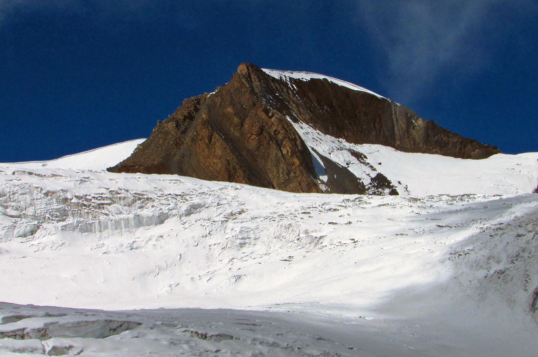 Tabsar southwest top (Peak 6,056m). The Nepali route of ascent reached the base of the right skyline (northeast) ridge and followed it over loose rock and snow to the top.