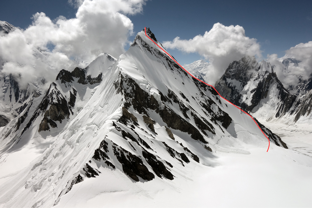 Khalkhal West seen from Khalkhal Pass. The original Dutch route climbed onto the northwest ridge, facing the camera, from the right and followed the crest to the summit. The new Chilean route (2017) on the southwest ridge is marked.  Khalkhal East is the lower summit immediately left, while the rocky summit visible behind the lower part of the southwest ridge is Marble Peak.