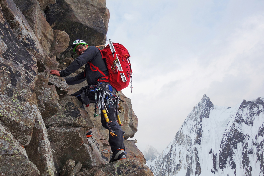 Alejandro Mora on the rocky section of the southwest ridge of Khalkhal West, with Crystal Peak behind.