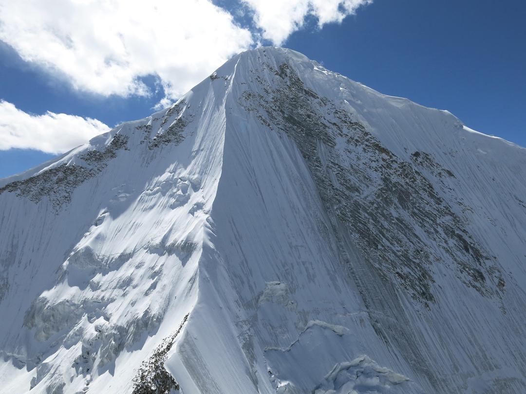 The north ridge of unclimbed Nya Kangri (6,480m) seen from Sumur Kangri.