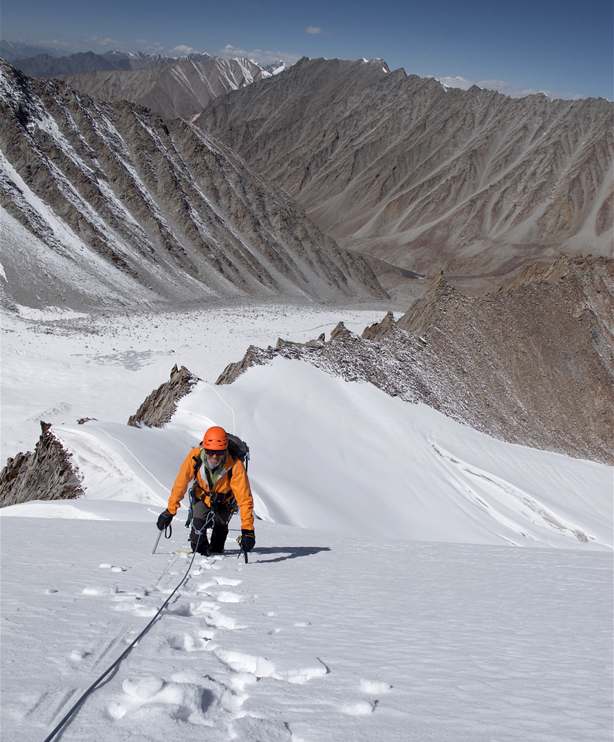 Derek Buckle on the first ascent of the west-northwest ridge of Sumur Kangri (5,991m), with a view down the arid Sumur Valley.