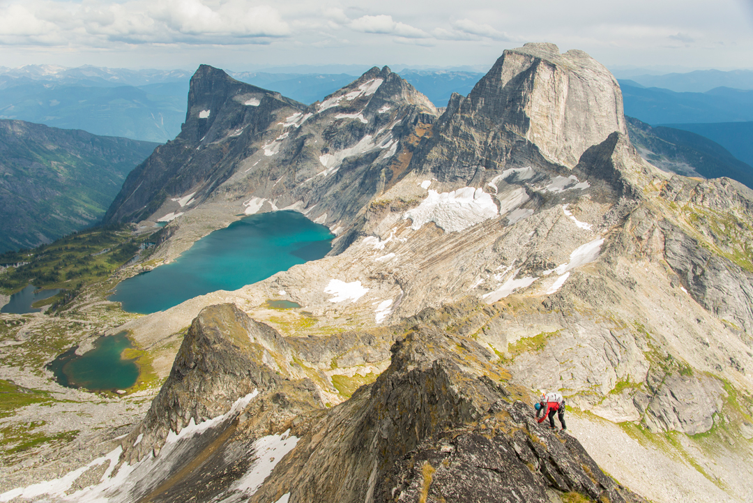 Scrambling to the summit of Midgard Peak, with the peaks on the south side of the Mulvey Lakes Basin in the background. Vince Hempsall and David Lussier traversed all 13 peaks around the basin in August 2017.