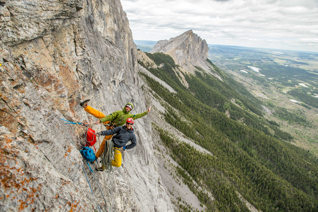 Mark Carlson and Tyler Kirkland looking chuffed at the pitch 19 belay on Fluffy Goat Butt-face, with Yamnuska in the background.
