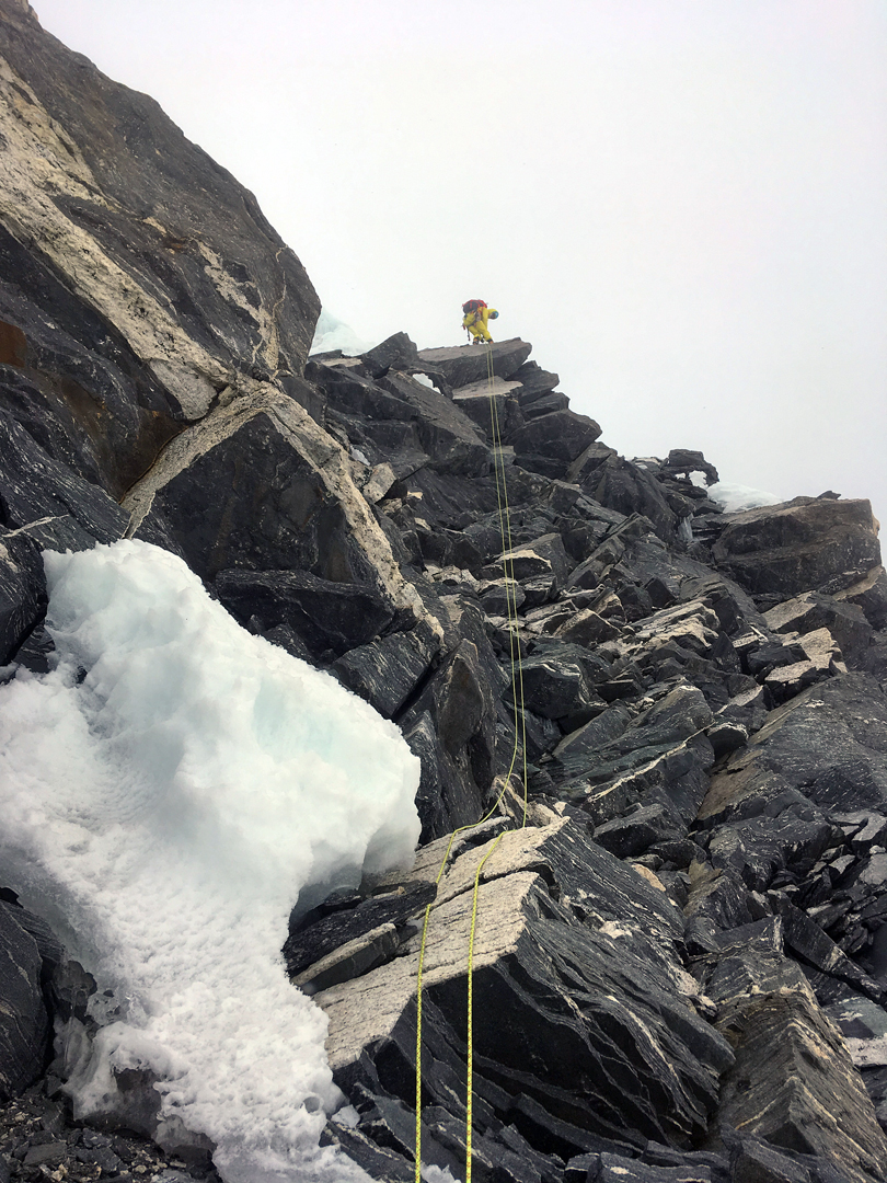 Negotiating loose, blocky terrain on the west-southwest ridge of Chugimago during the descent.
