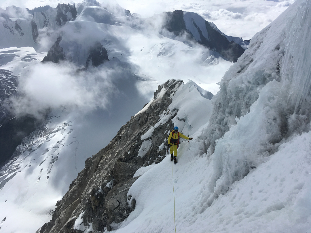 Mike Arnold high on the west-southwest ridge of Chugimago, with Ramdung (5,930m) behind.