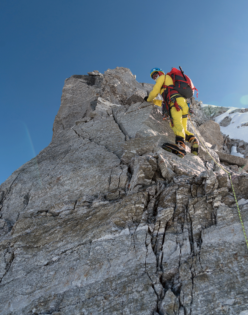 Mike Arnold tackles a rock step on the lower section of the west-southwest ridge of Chugimago.