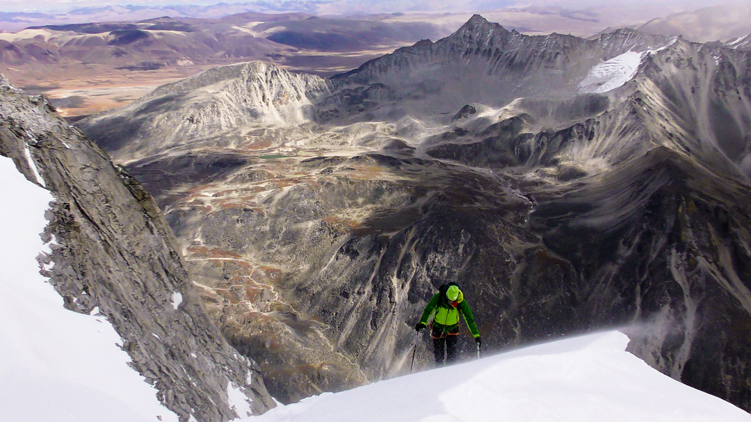 Nils Beste during the first ascent of Sunkala Topi (5,865m), with the pass of Namja La in the background.