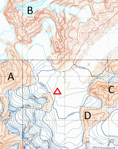 An overview of the south fork of the Fish Glacier in Alaska's Revelation Mountains. (A) Mephisto (8,568'). (B) Obelisk (9,304'). (C) The Charlatan (7,350'). (D) The Prophet (6,905'). The triangle shows the 2017 climbers' base camp.