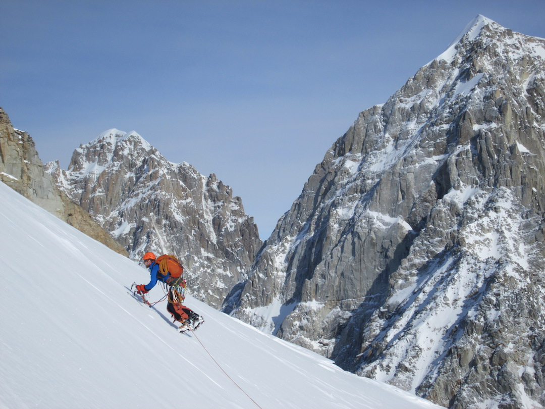 Frieder Wittmann cruising up the summit slopes of Mephisto during the first ascent of Langstrasse (800m, WI4 M4). In the background is Jezebel (9,650') on the left and the Obelisk (9,304') on the right.