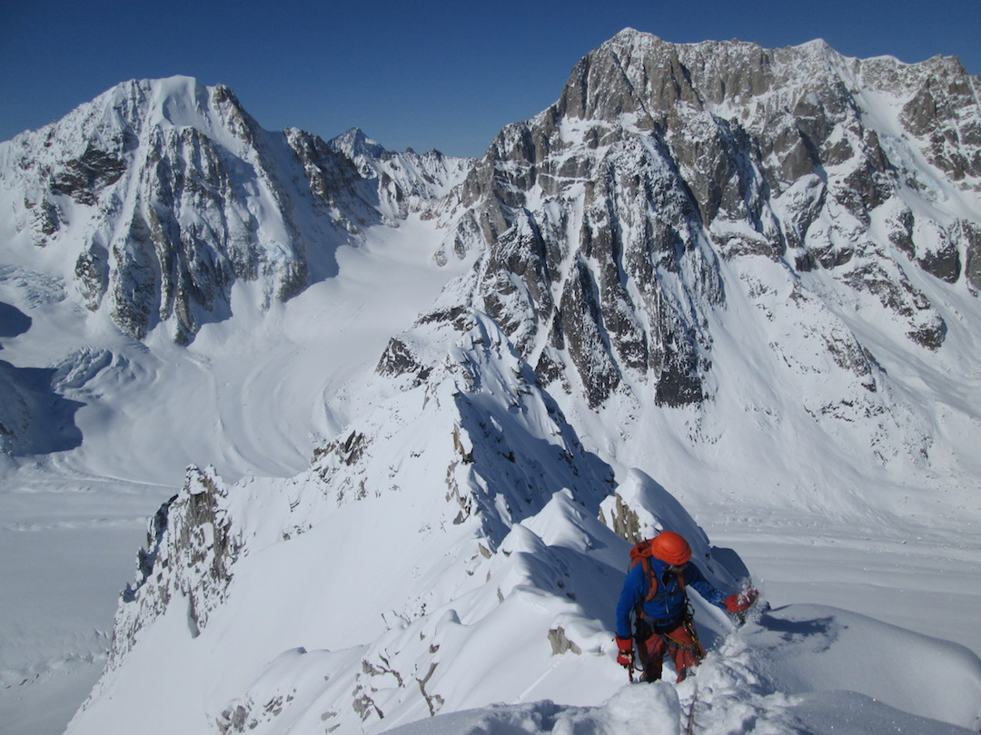 Frieder Wittmann coming up to the summit of the Charlatan after making the peak's first ascent. Mephisto is behind on the left, and the southeast face of the Obelisk is behind on the right.