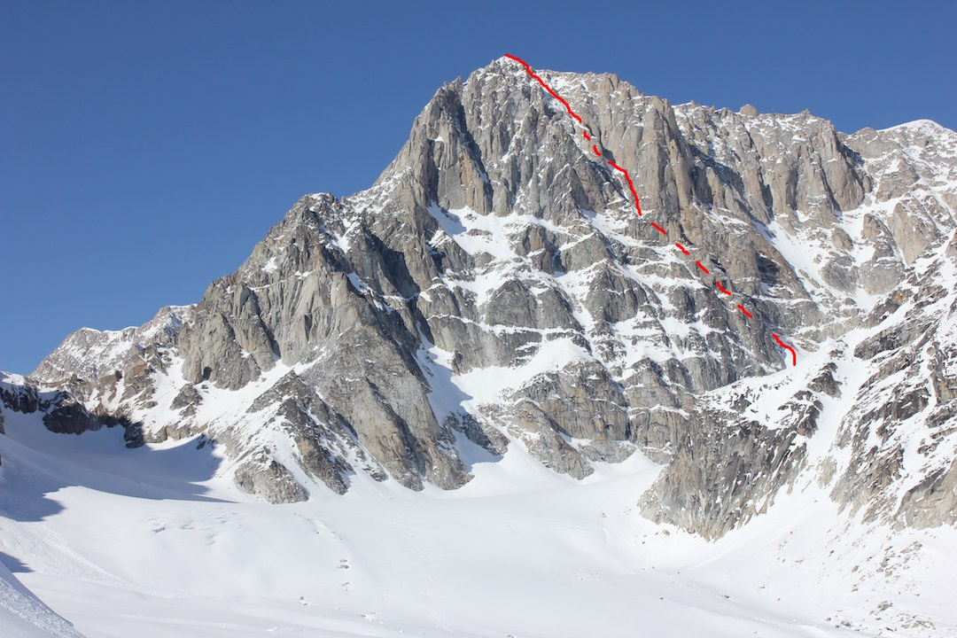 The southeast face of the Obelisk, showing the line of Alternative Facts (900m, WI5 M6 A1). John Giraldo and Clint Helander made the first ascent of the Obelisk (Peak 9,304') in 2015 via Emotional Atrophy (1,000m, WI5 M6 A0), on the mountain's southwest face.