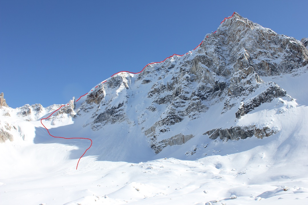 The Charlatan (Peak 7,350'). After two attempts, Gedas Simutis and Frieder Wittmann succeeded in climbing the peak via the east ridge, only partially visible in this photo, via a new route they named Piled Higher and Deeper (AD).