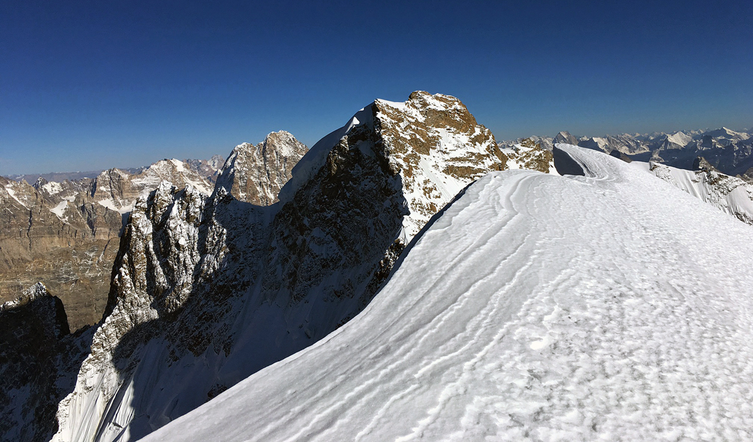 Looking east at unclimbed Barnaj II (ca 6,460m). Behind and to the left is Hagshu, with the north face of the north top in profile. Left again, and in the distance, is the broad-topped summit of Hana's Men. x
