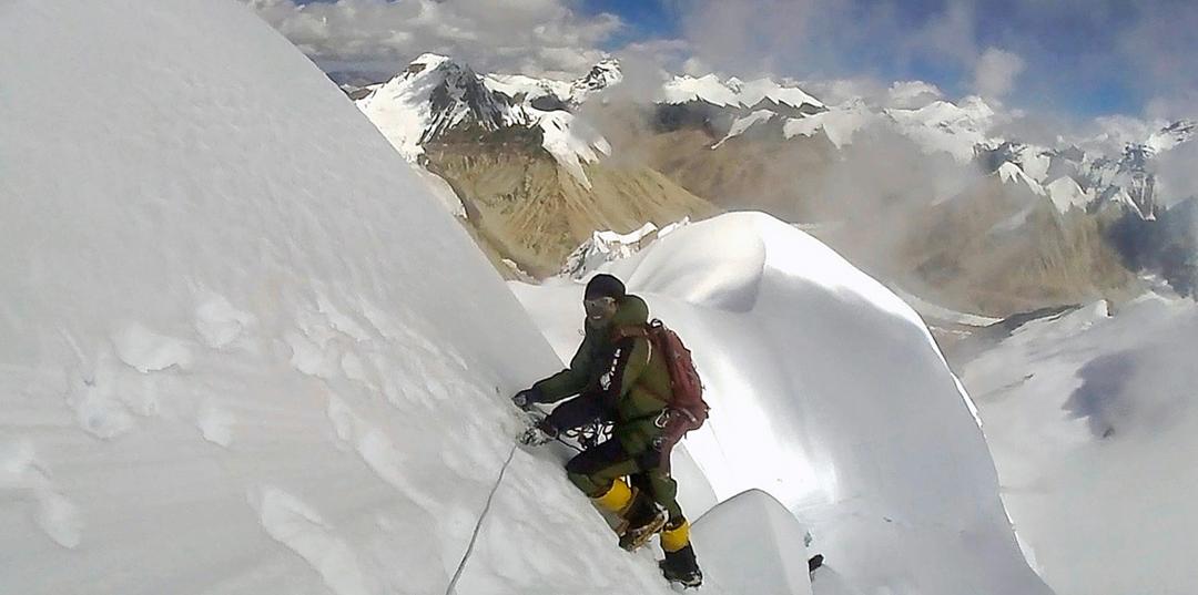 Naga Dorje Sherpa descending from the summit of Burke Khang. Behind lie Tibetan peaks above the West Rongbuk Glacier.