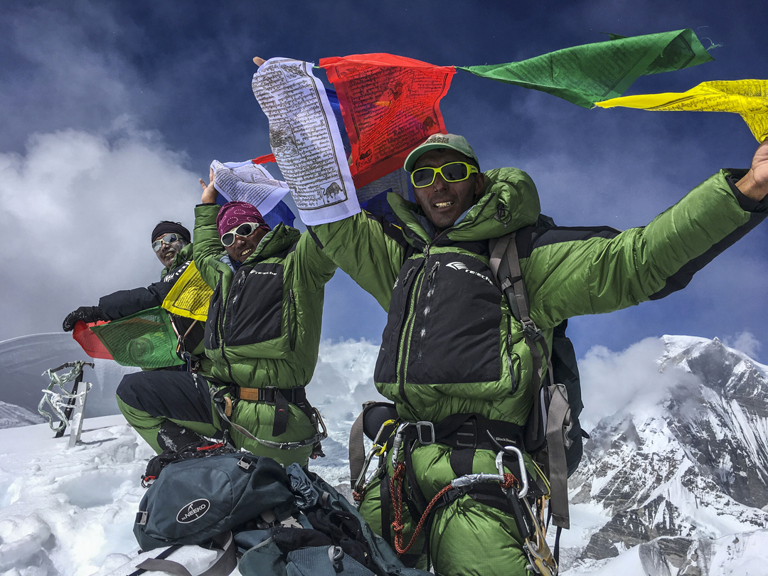 From left to right: Naga Dorjee Sherpa, Samden Bhote, and Pemba Tshering Shepa on the summit of Burke Khang.