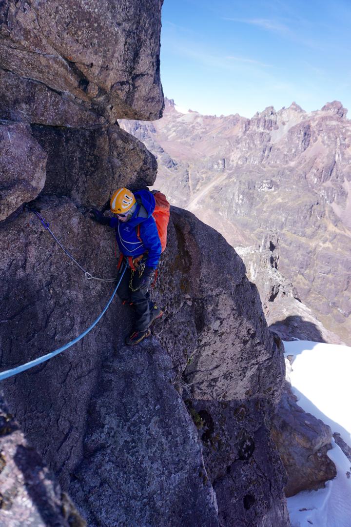 Jeanne Zimmerman rounds an airy arête on the summit block of Gabarriti.