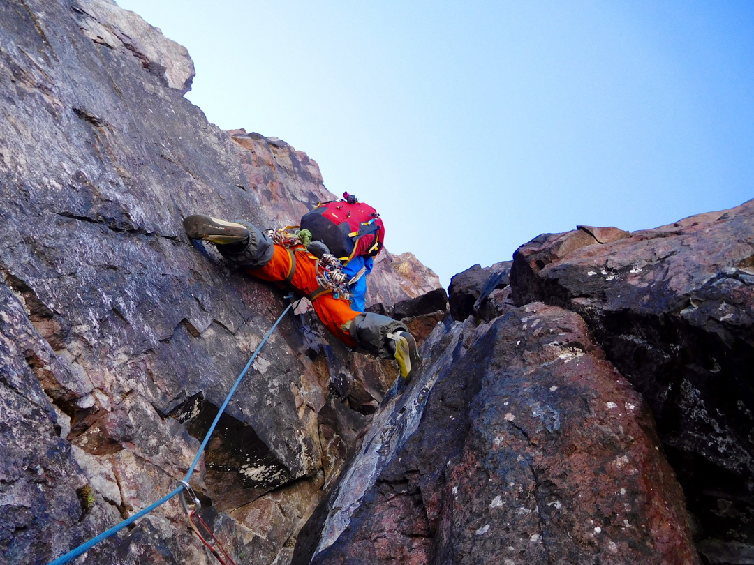 Derek Field leads the 5.10a dihedral pitch on the summit block of Gabarriti.