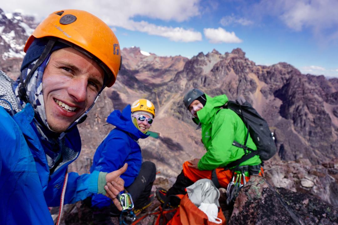 Derek Field, Jeanne Zimmerman, and Aaron Zimmerman celebrate on the summit of Gabarriti.