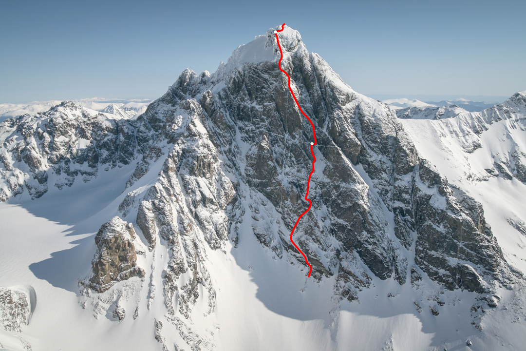 Route line for Game of Thrones (1,250m, ED2 5.10a) on the southwest face of Monarch Mountain. The pair descended the glaciated west face, partially visible at left.