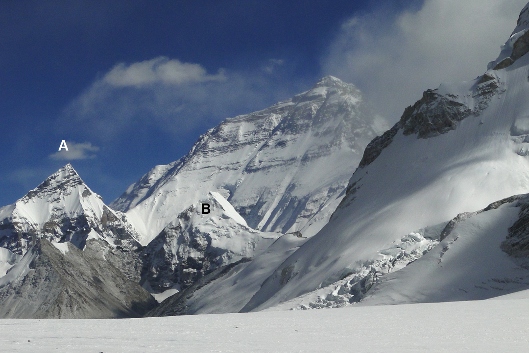 Seen from the upper Nup La Glacier, the north face of Everest towers over (A) Changtse (7,583m) and (B) Lingtren (6,749m). The foreground slopes on the right form part of the lower section of the east-northeast ridge of Burke Khang.