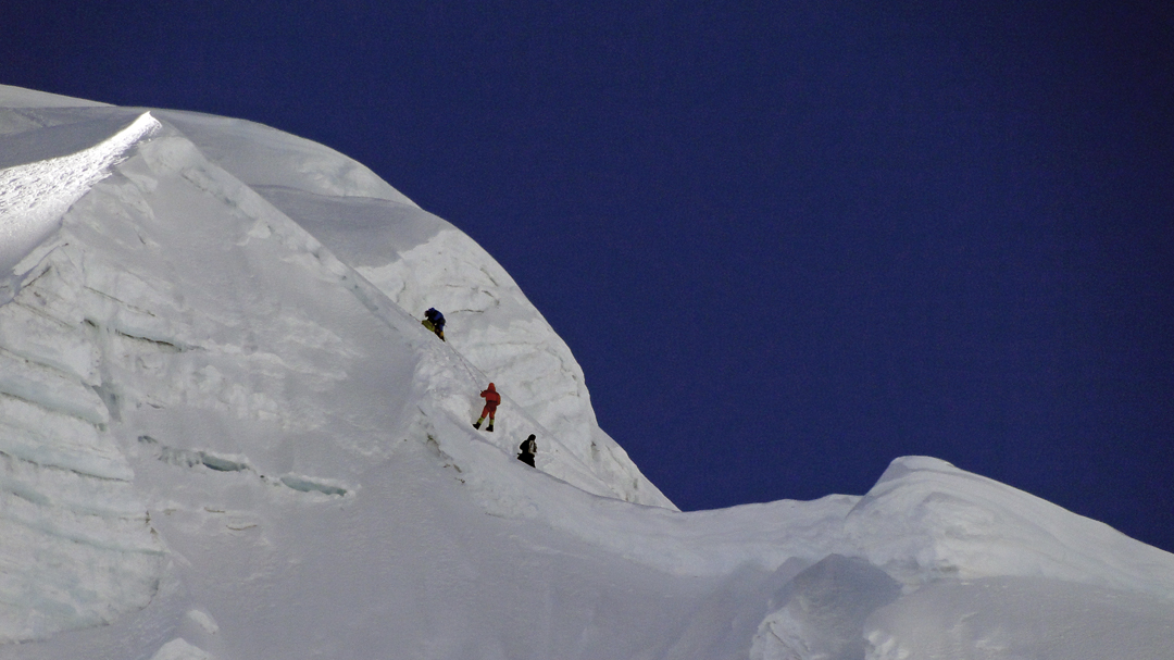 Climbing the northwest ridge of Tharke Kang during the first ascent.