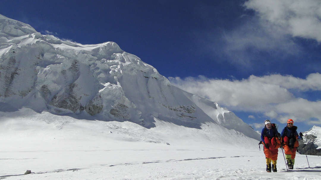 The lower section of the northwest ridge of Tharke Kang seen from the Nup La Glacier. The expedition gained the ridge via the smooth snow and ice slope above and a little left of the climbers.