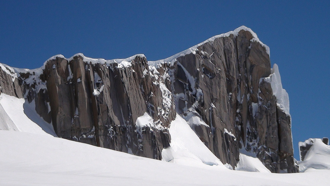 The east side of Punta Anna (2,365m) from below. The route followed a snow ramp on the left (south) skyline.