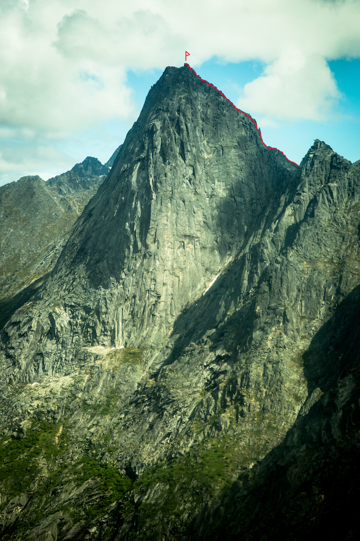 The south face of the Dogtooth in the Ramparts of the southern Alaska Range. Eye Level (1,200', 5.6) follows the southeast ridge on the right-hand skyline. The striking, sunlit southeast face is unclimbed.